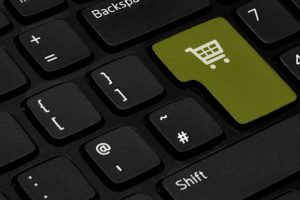 A keyboard with the enter key replaced with a shopping basket icon.